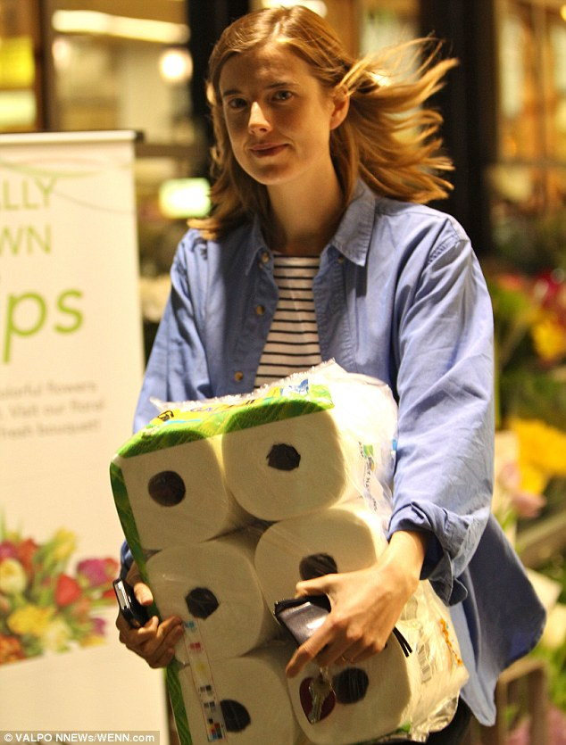 Got enough rolls? The model's life looked far from glamorous as she left the shop with a number of paper towels
