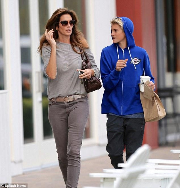 Model looks: Presley stood almost shoulder-to-shoulder to his 5 ft 9 supermodel mom