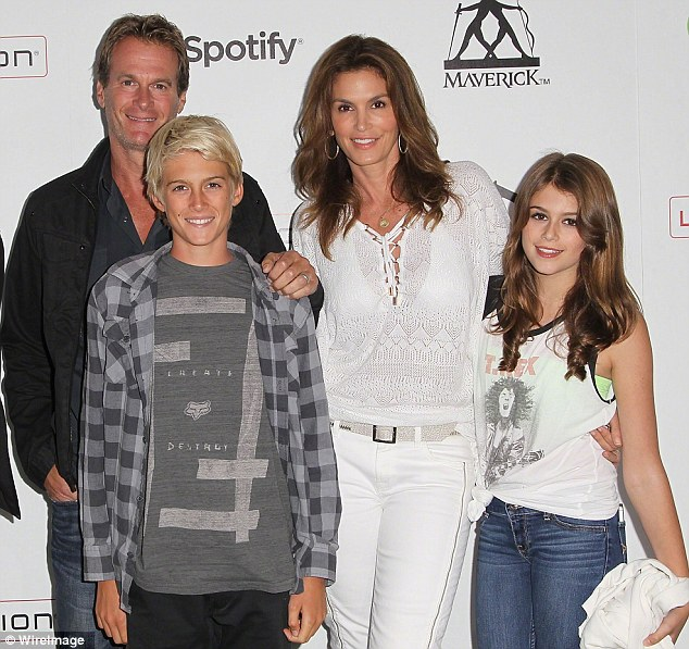 Family affair: The cover girl stepped out with husband Rande Gerber and both their kids, Presley and Kaia, 12, to attend a bash on July 4, 2013