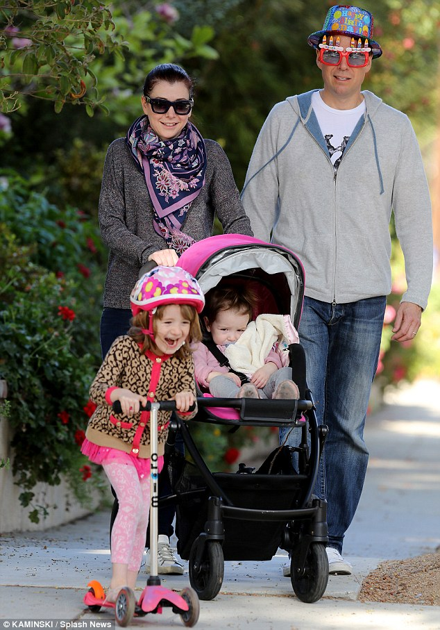 Hip hip hooray: Alyson Hannigan and her daughters Satyana and Keeva took their father Alexis Denisof for a birthday walk around their Los Angeles, California, neighbourhood on Tuesday