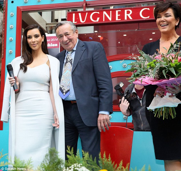 Fancy trip: Kris Jenner (far right) looked happy as daughter Kim Kardashian posed with billionaire Richard Lugner, 81, in front of his mall in Vienna, Austria on Thursday