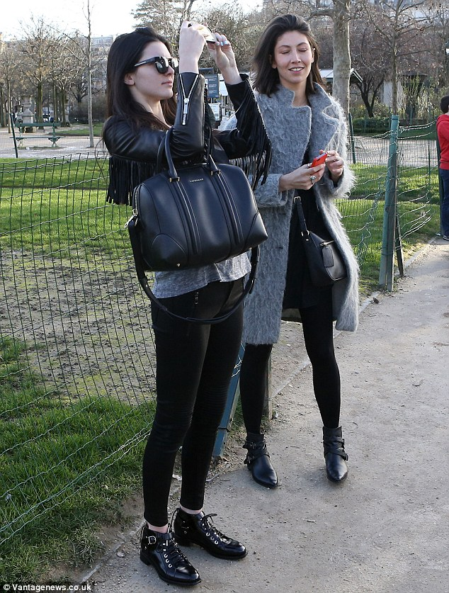 Trés chic: The reality star wore Christian Dior sunglasses and a Givenchy purse as she took in the sights