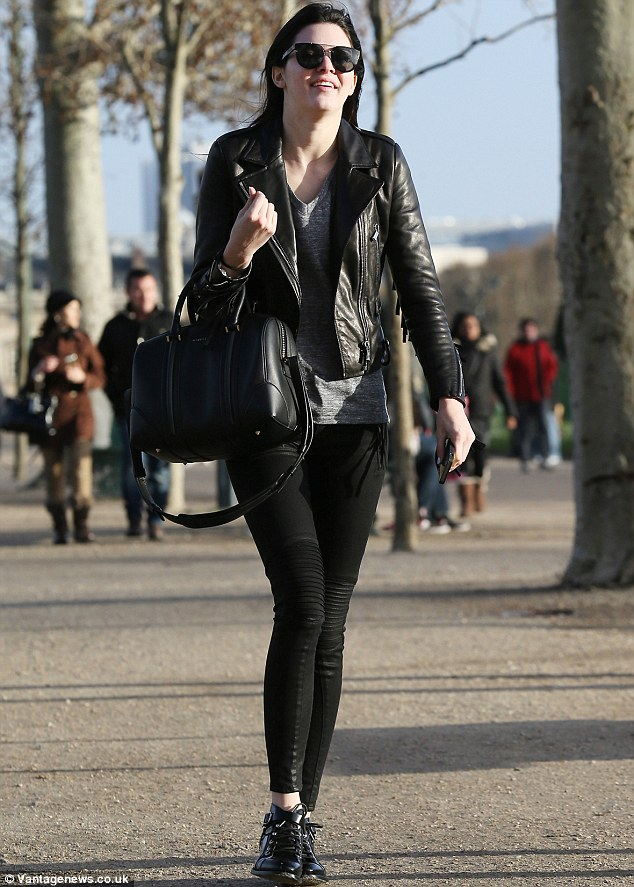 Cool look: The 18-year-old wore a fringed black leather jacket with skinny slacks as she played tourist