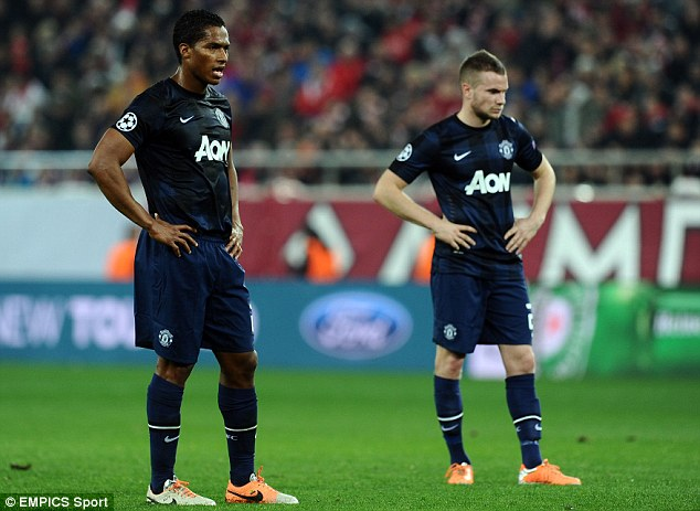 Do not pass go: Cleverley (right) gave the ball away with frightening regularity against Olympiacos
