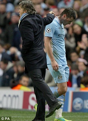 Snubbed: Johnson is substituted before half time by then City boss Roberto Mancini