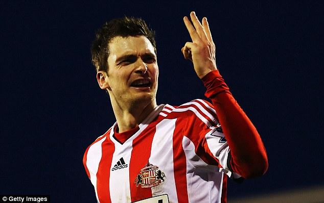 Hero: Adam Johnson celebrates scoring a hat-trick for Sunderland against Fulham