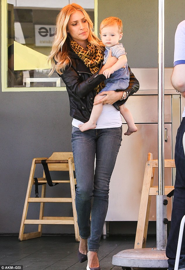 Maternal instinct: The trim star protectively held onto her young son in Beverly Hills in July