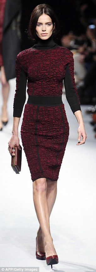 A model wears an outfit from Nina Ricci's collection on the catwalk at Paris Fashion Week