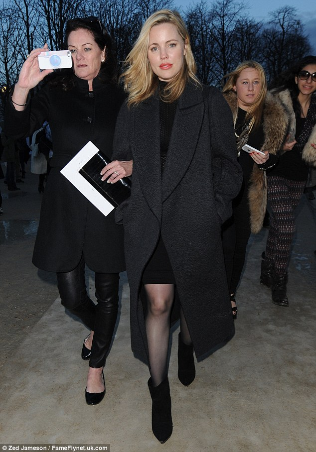 Melissa George rugs up with a stylish winter coat as she arrives at Nina Ricci's show at Paris Fashion Week