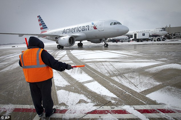 Disruptive: An American Airlines jet at Philadelphia airport yesterday. The city's airport is one of several that may be affected by ice storm Titan