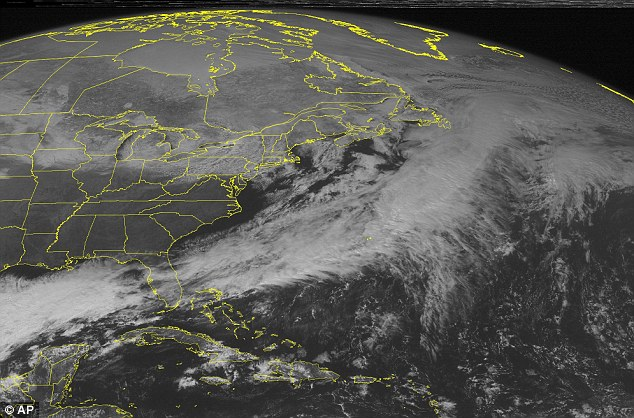 Storm front: A satellite image on Thursday shows clouds gathering across the Northeast and Great Lakes