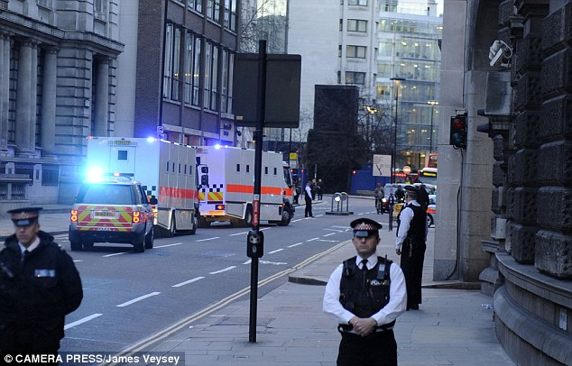 Prison vans carrying Michael Adebolajo and Michael Adebowale leave the Old Bailey after they were sentenced for the murder of fusilier Lee Rigby