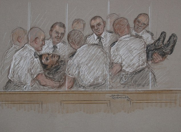 Chaos: Michael Adebolajo was carried from the dock, following the fight with his security detail