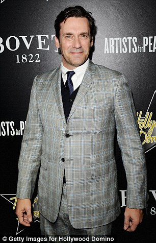 Here he comes: Jon Hamm, best known for his role as sixties advertising maverick Don Draper in Mad Men, arrives at West Hollywood venue Sunset Tower sporting a smart two-piece suit on Thursday evening