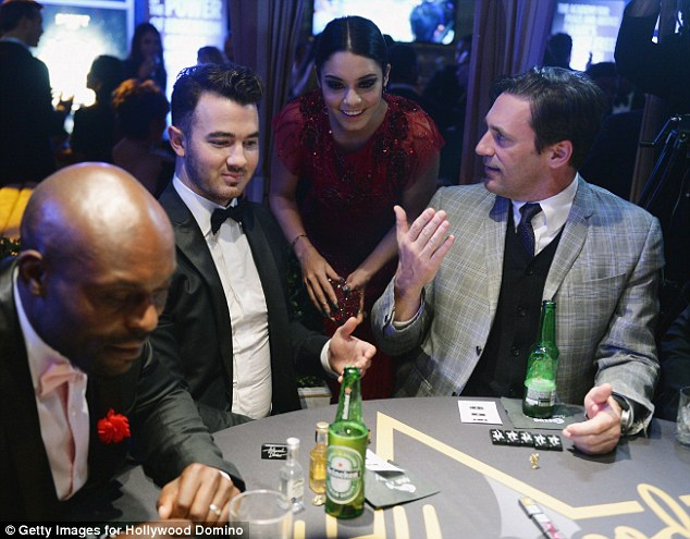What are the odds? Jonas, Hudgens and Hamm enjoy a chat while former Heroes star Jean-Louis focuses on the dominoes