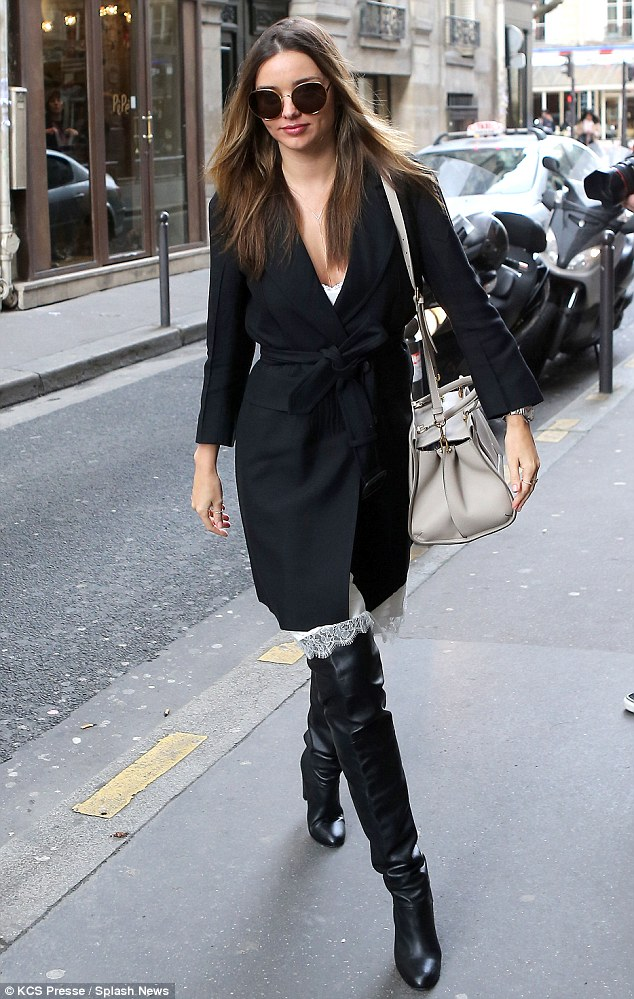 Great strides: Miranda Kerr sports a pair of raunchy thigh high boots during her latest outing in Paris on Friday