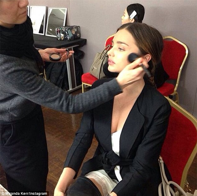 Don't mind me: The model gets a makeover backstage at the Sonia Rykiel runway show during Paris Fashion Week on Friday