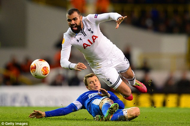 New look: Sandro sported a braided beard as the combative midfielder goes to ground after Ruslan Rotan's firm tackle