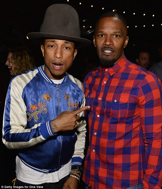 Is he really here? The hip hop artist looked star struck by Jamie Foxx