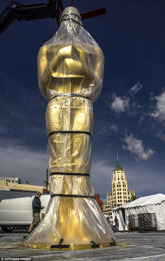 Not long now: A large Oscar statue waits to be installed outside the Dolby Theater on Hollywood Boulevard on February 27