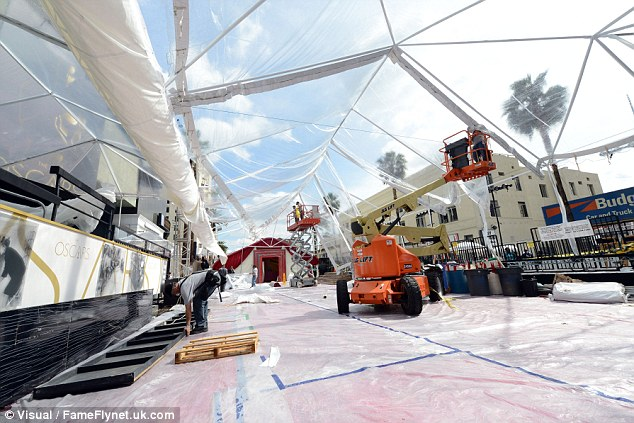 Special measures: The red carpet has been covered in plastic with tents overhead due to a freak flood warning