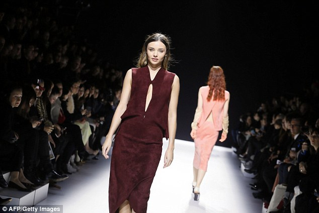 Daring: The model showcased a stunning deep purple dress with cut-out sections