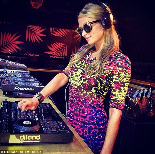 Working it: Paris pictured DJing in Brazil for Carnival in an Instagram snap posted on Thursday