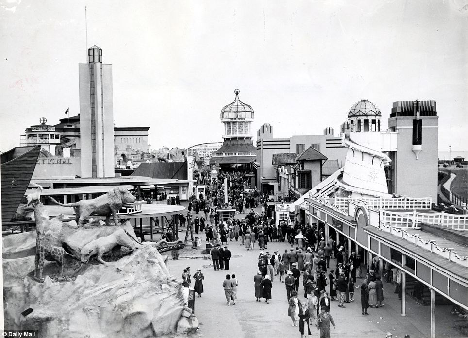 Nostalgia: Holidaymakers mill around Blackpool's amusement part in a picture taken in 1935, when the resort was at the height of its popularity