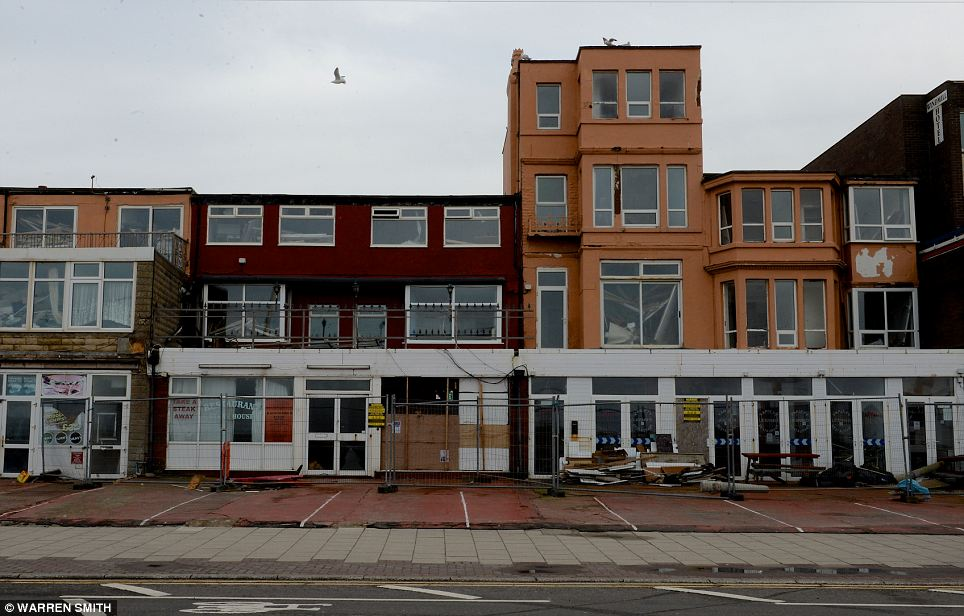 Not open for business: The un-boarded windows of these Blackpool properties reveal the ruin they have been left inside