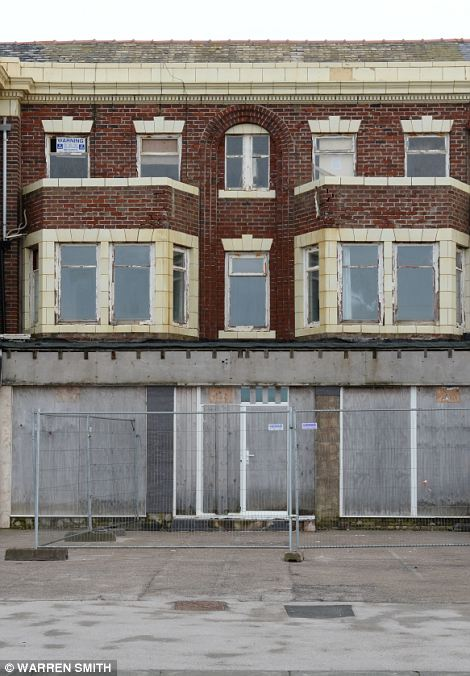 Now nameless: Not even a sign remains as a reminder that this battered shopfront was once part of now-moribund Blackpool's tourist industry