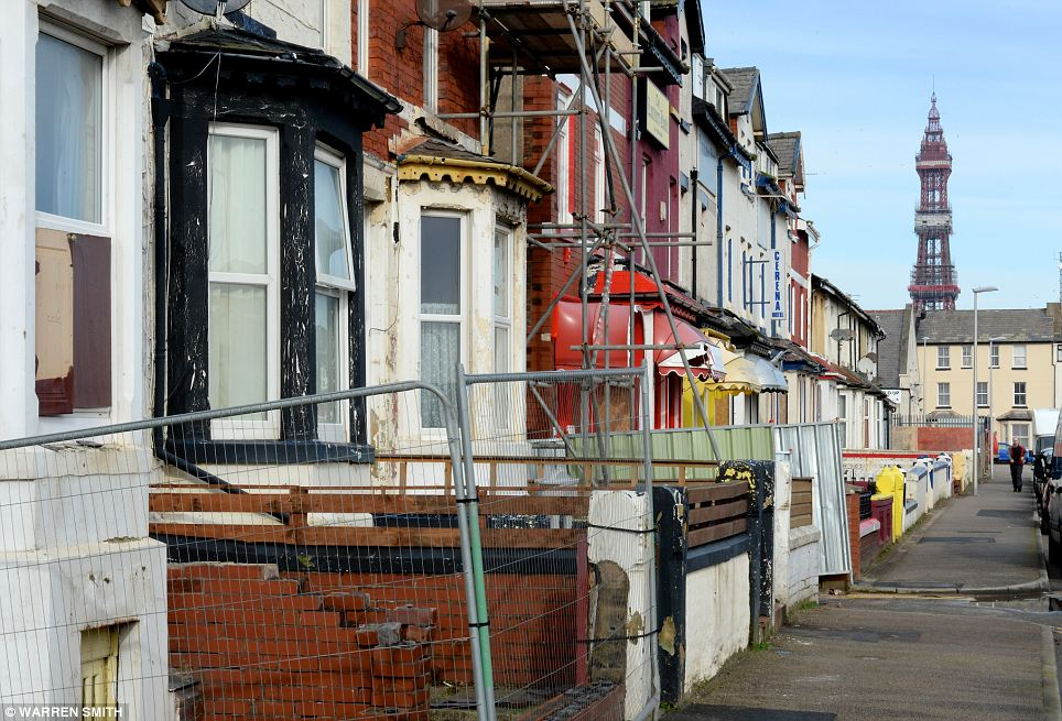Remnants of the past: The Blackpool Tower rises in the background, overlooking streets of closed guest-houses and lonely residential properties