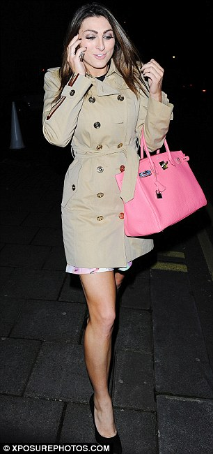 Style queen: The 26-year-old was spotted leaving The Dorchester hotel on Thursday evening in a nude-colour mac carrying a very expensive Birkin handbag