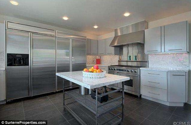 Spotless: The gourmet kitchen boasts clean lines and stainless steel appliances