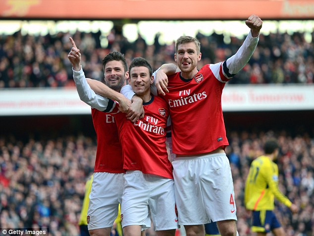 Crazy year: Arsenal are one of four teams competing for the Premier League title this season