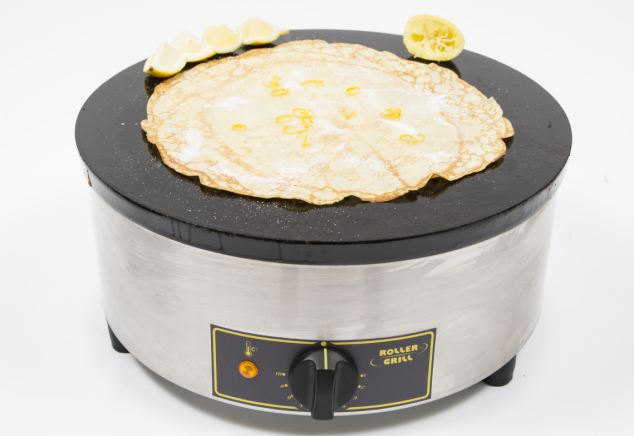 The Roller Grill CFE 400 Crepe Maker with pancake topped with lemon & sugar is great for big groups
