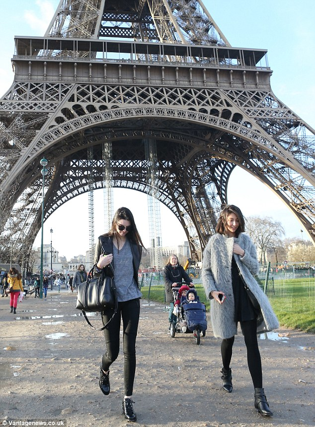 Enjoying the scenery: The day before, Kendall went sightseeing with a friend and took many photos of the Eiffel Tower