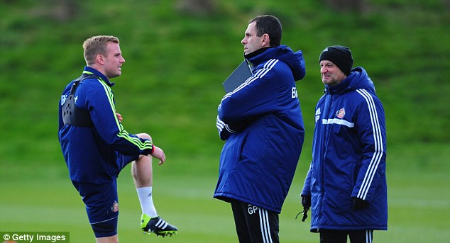 Words of wisdom: Poyet chats with Lee Cattermole (left) during the session at the Academy of Light
