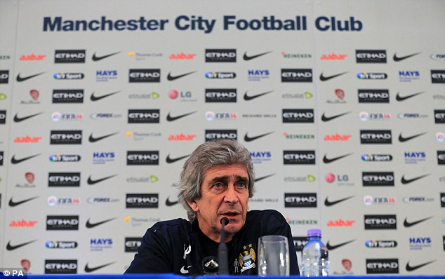In the hotseat: Manchester City manager Manuel Pellegrini speaks to the media at Carrington