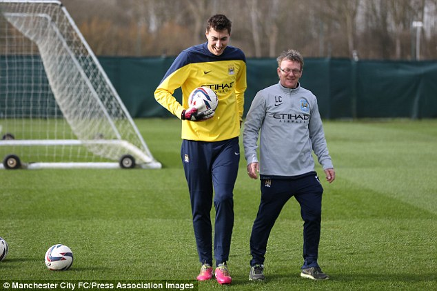 Frontrunner: Manchester City goalkeeper Costel Pantilimon (left) is expected to get the nod