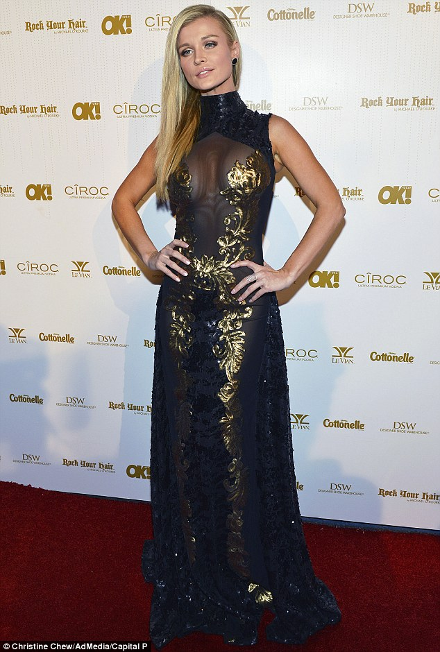 Gleaming goddess: Joanna Krupa showed off her figure in a sheer black and gold-embellished dress at the OK! Magazine Pre-Oscar Party at Greystone Manor Supperclub in LA on Thursday