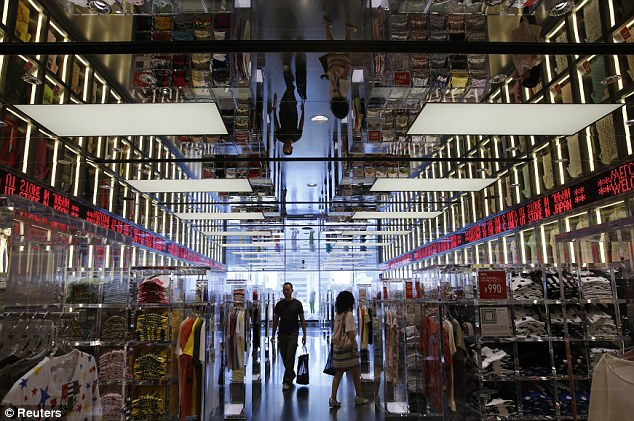 All-encompassing: Fast Retailing also owns other brands including Uniqlo (pictured) Helmut Lang, Theory, Princess Tam Tam and French label Comptoirs des Cotonniers. It's reportedly worth $36billion
