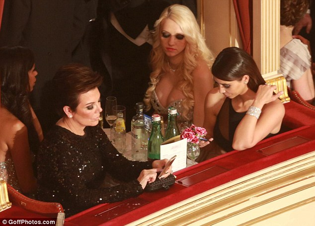 Anywhere but here: Both Kris and Kim seem preoccupied to say the least as they endured a night at the Opera