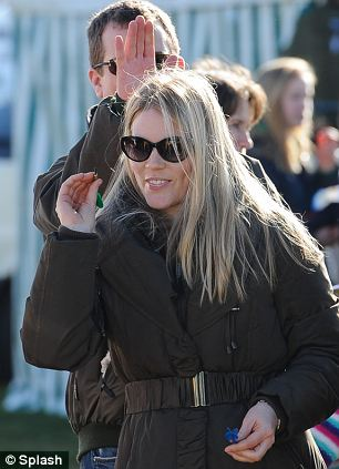 On the oche: Autumn Phillips prepares to throw a dart as she tries her hand at a carnival game at the Duke of Beaufort's Point-to-Point races
