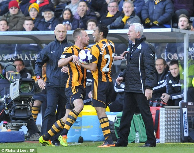 Clashing point: David Meyler had to restrained by fellow player Hull City player Ahmed Elmohamady