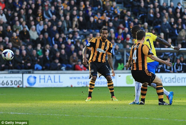 Opener: Sissoko shoots past Hull's Alex Bruce to open the scoring in the early stages of the match