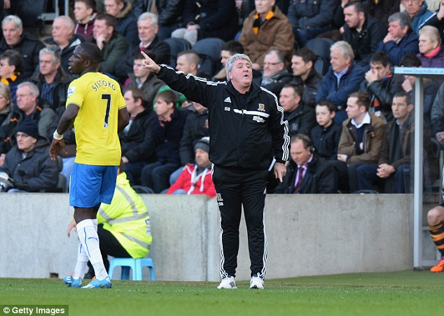 Orders: Hull manager Steve Bruce shouts instructions from the touchline as he watches his side suffer defeat
