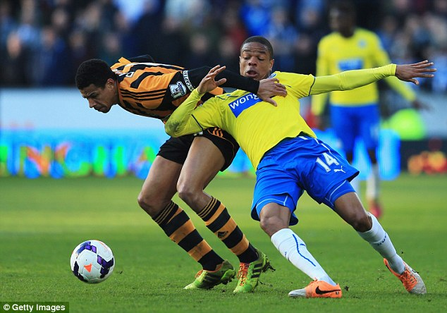 Rough and tumble: Davies (left) battles at close quarters with Remy (right) for the ball