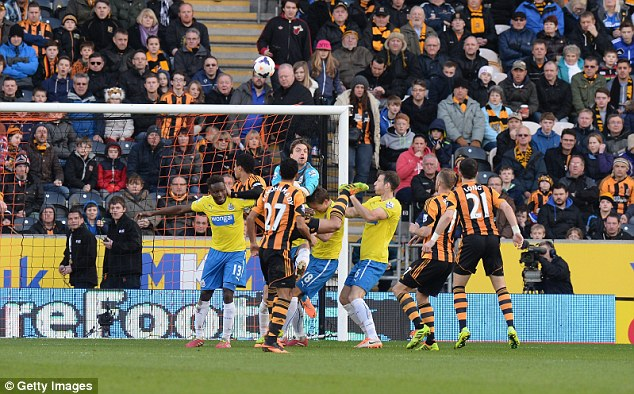 Up and over: Curtis Davies see his header loop over Newcastle goalkeeper Tim Krul