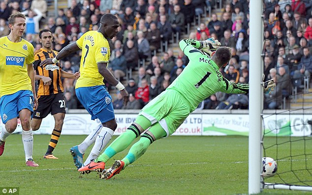 Desperate dive: Hull goalkeeper Alllan McGregor fails to stop Sissoko scoring his second goal