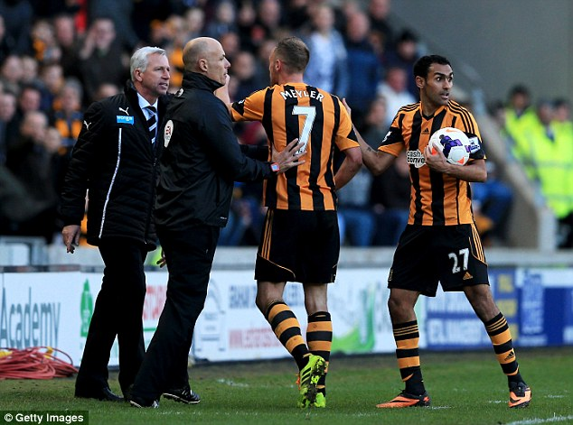 Kicking off: Fourth official Howard Webb restrains Meyler as he points at Pardew